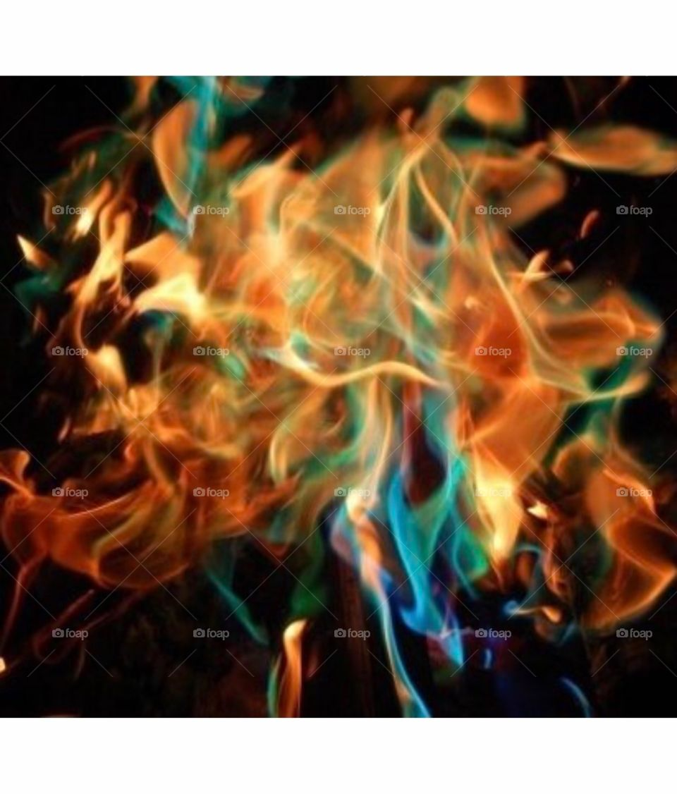 Fire is mesmerizing. Campfire with colour making powder. So amazing. Orange, purple, yellow, red, green and blue.