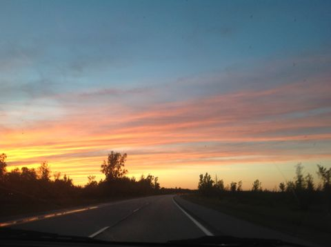 Red Sky at Night. Beautiful sunset above a winding rural road