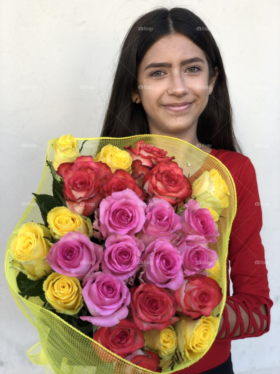 Young girl with a colorful bunch of roses