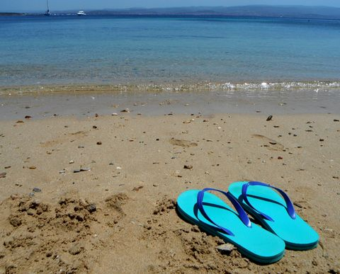 sandal in front of sea