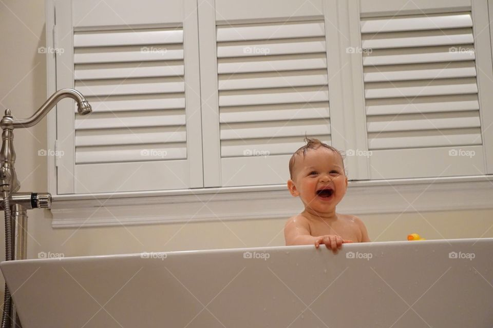 Baby in a bath tub. Tubby time