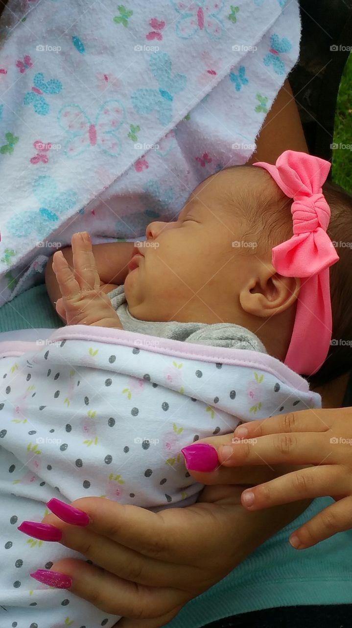 newborn with hand up