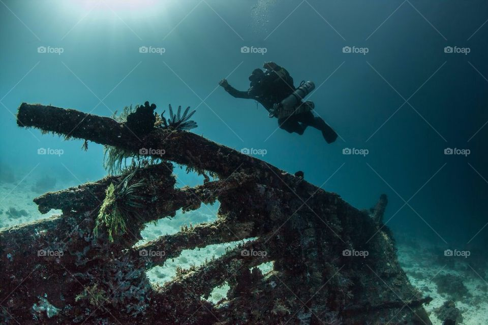 Diver flying over a shipwreck