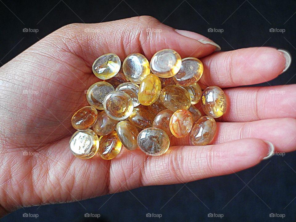 Hand holding glass beads