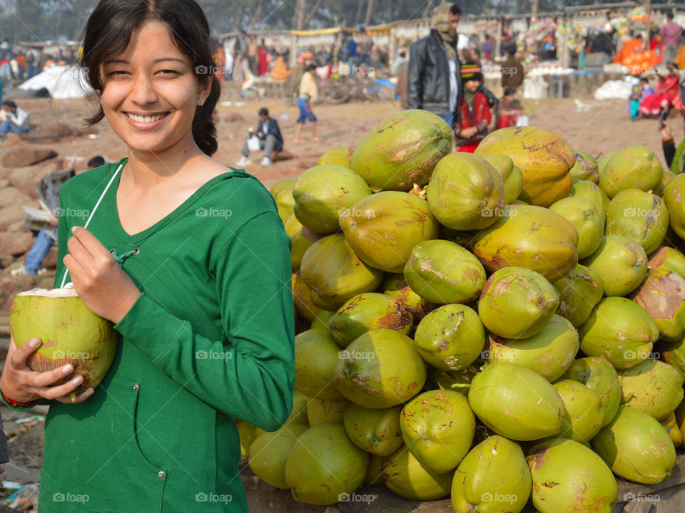 Young woman drinking coconut water