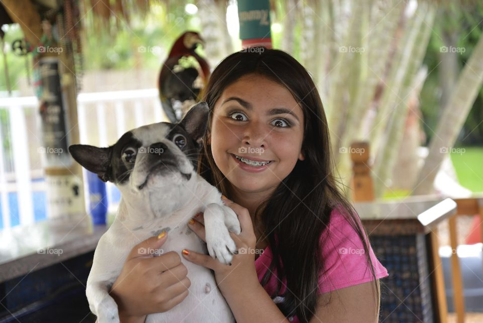 Portrait of a teenage girl with her dog