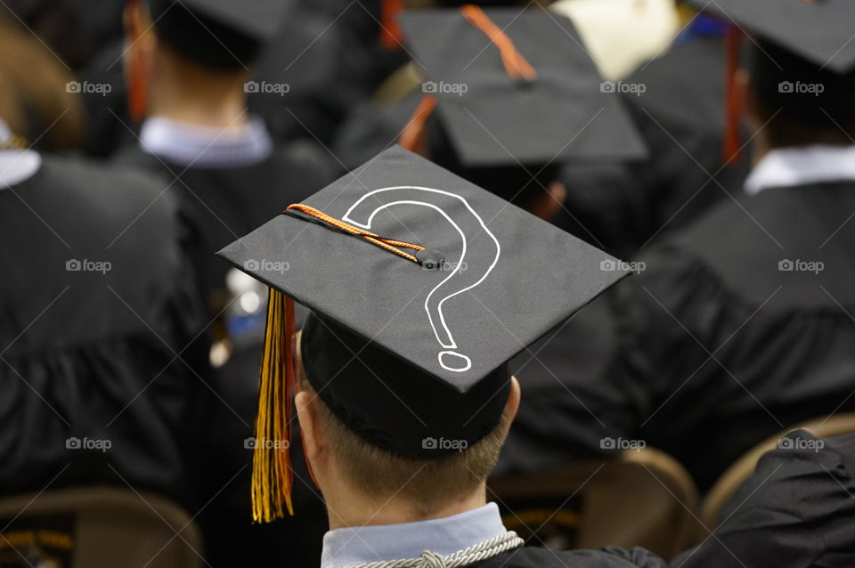 Rear view of graduates in caps and gowns