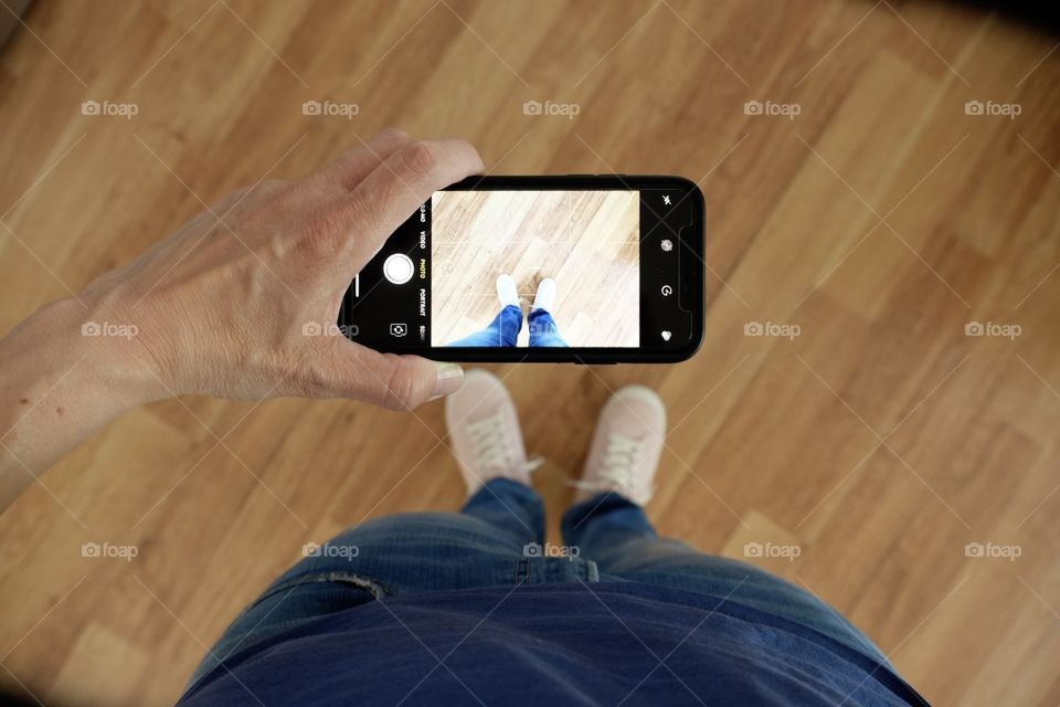 Girl With iPhone X Photographing Shoes, Photograph Of A Photograph, Camera Within A Camera, Photographer's Viewpoint