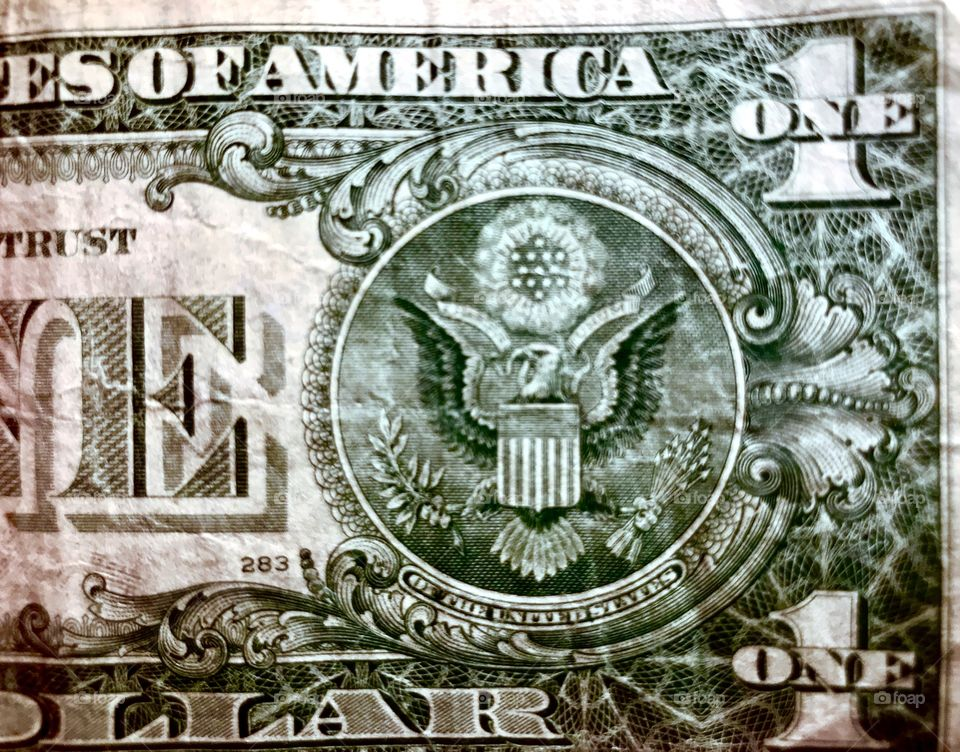Old used dollar bill. Folded many times in many different wallets and cash drawers. Shot close up and done in sharp detail.