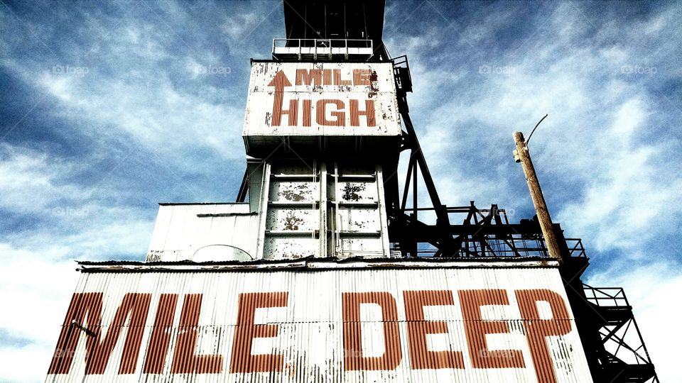 Mile High Mile Deep. A historic head frame towering over the town of Butte which sits a mile above sea level. not much else to look up to.