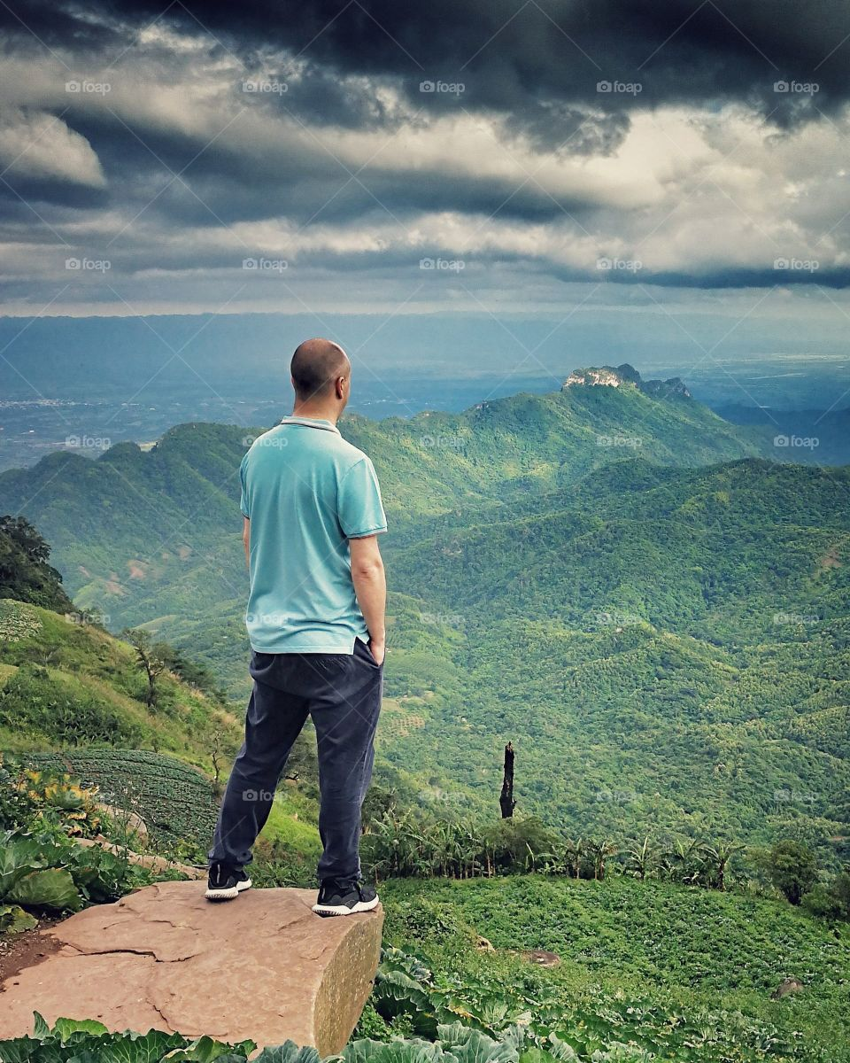 Travel and Landscape photographer overlooking landscape in Thailand