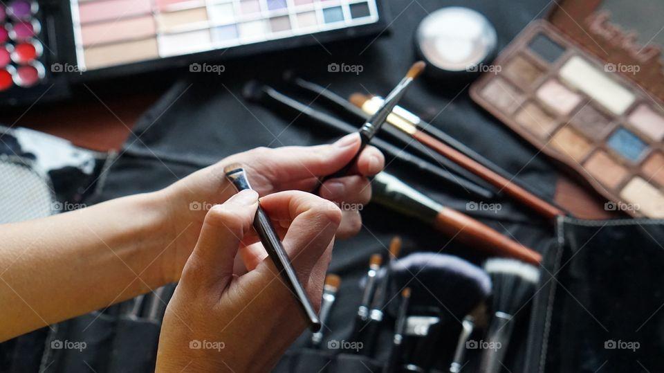 A woman applying make-up on hand