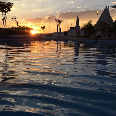 A beauty sunset behind silhouette water pool