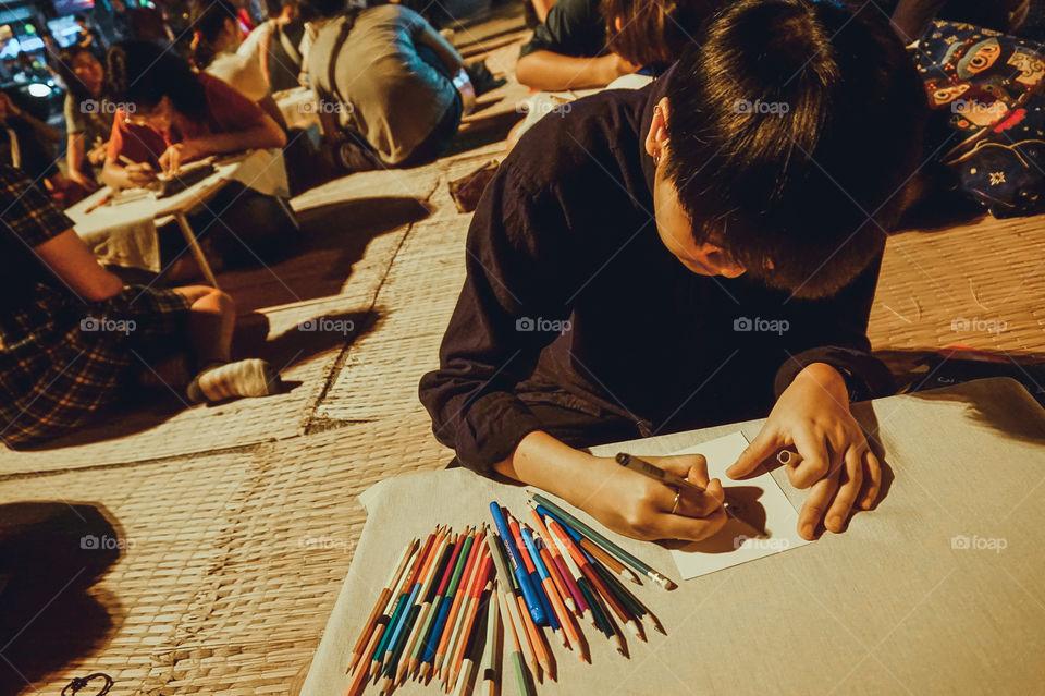 Portrait drawing for an art class, Thailand