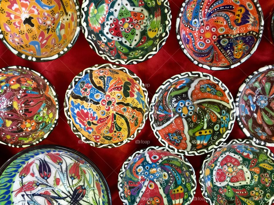 Old souk in Dubai selling colourful small bowls
