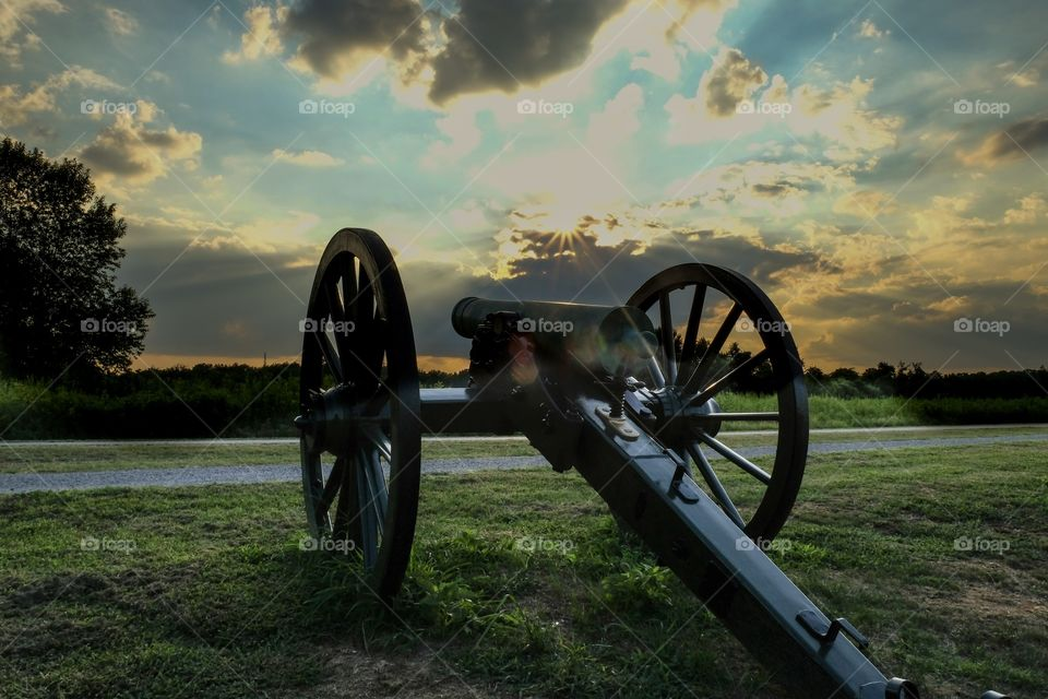 An old cannon points towards the sunset at Stones River National Battlefield in Murfreesboro Tennessee. This battle had the highest percentage of casualties on both sides of any major battle in the American Civil War.