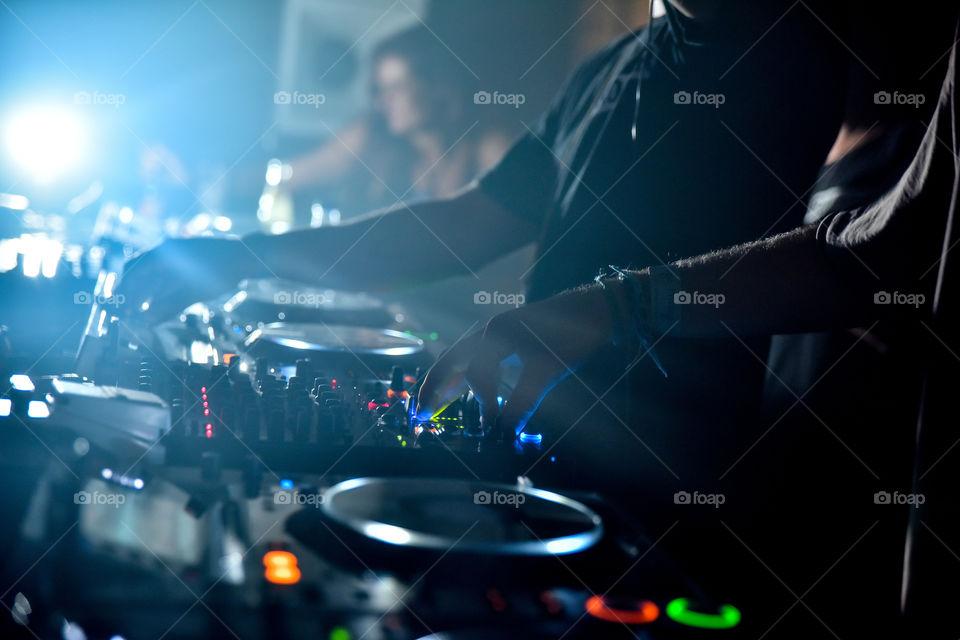 dj-ing in a club in Ibiza