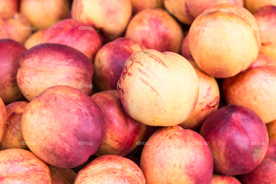 Fresh Nectarines Peaches Fruits In Grocery Supermarket