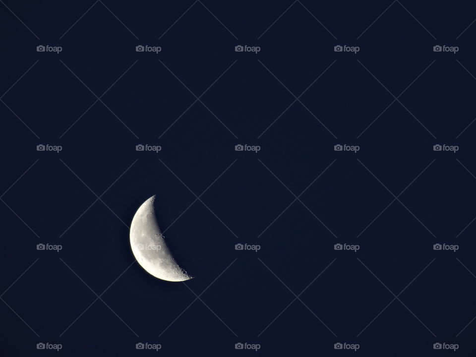 The crescent moon in the space