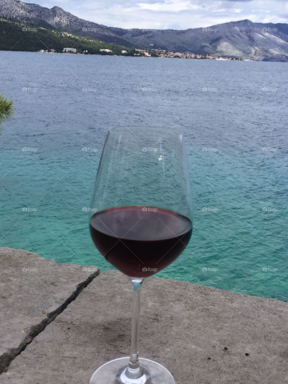 Glass of Croatian wine on the Adriatic Sea on the island of Krčula