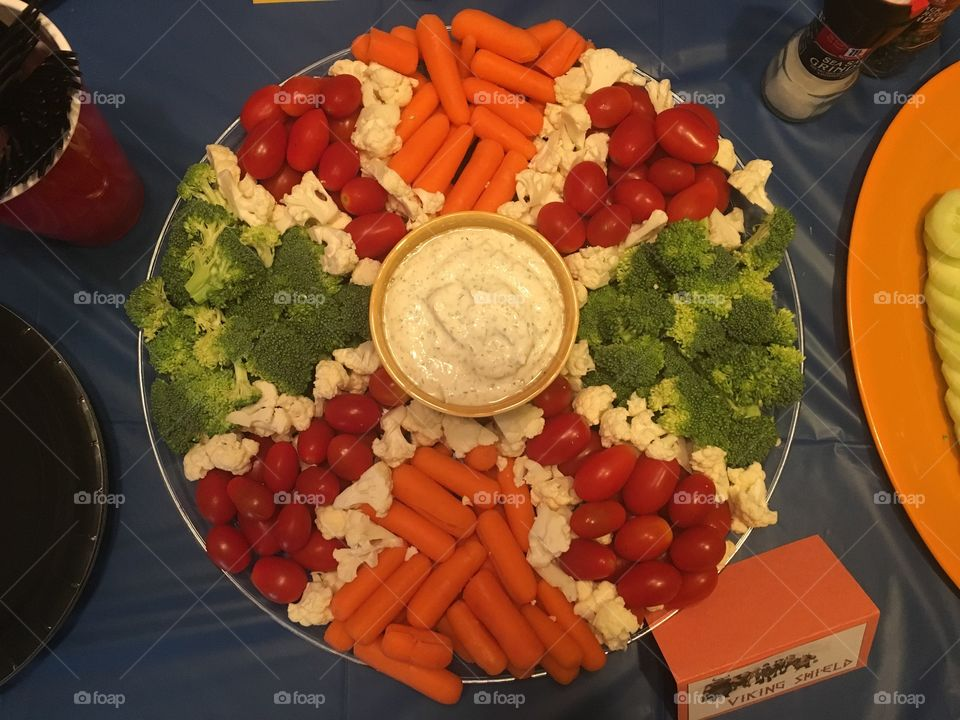 Shield made out of vegetables for a how to train your dragon themed birthday party