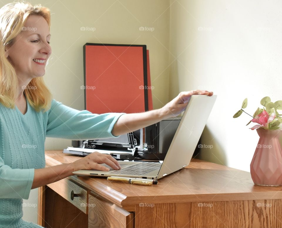 Woman opening her laptop