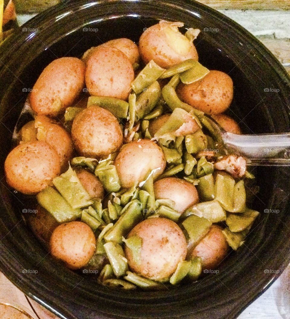 Cooking in the crockpot simmering vegetables all day fir savory taste