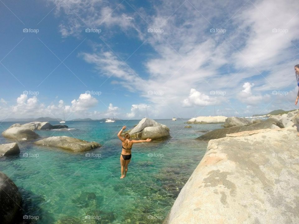 Cliff jumping . Virgin Gorda, British Virgin Islands