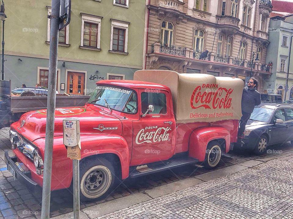 Man posing on truck in city