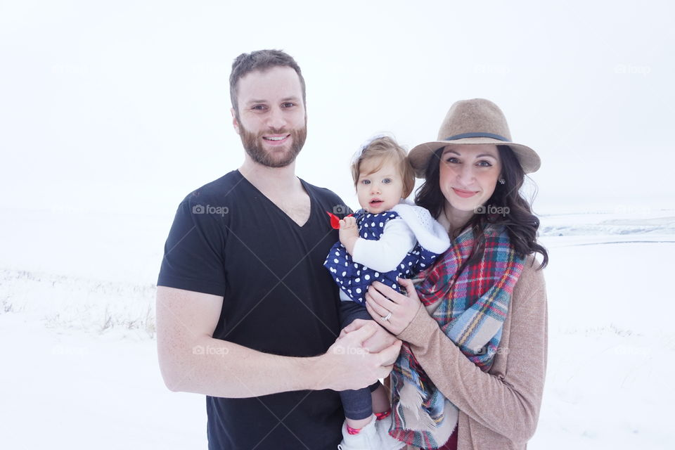 Portrait of happy family standing in snowy weather