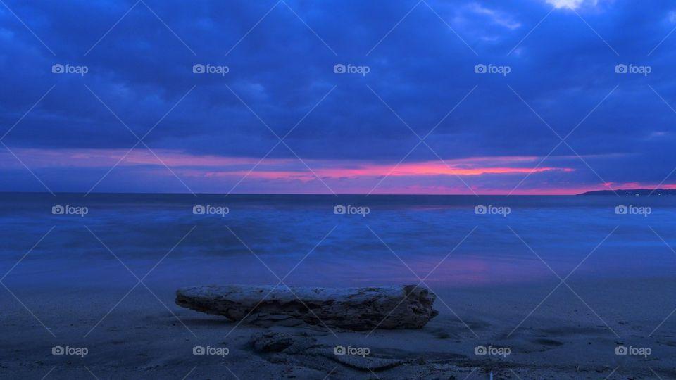 Beach log and sunset