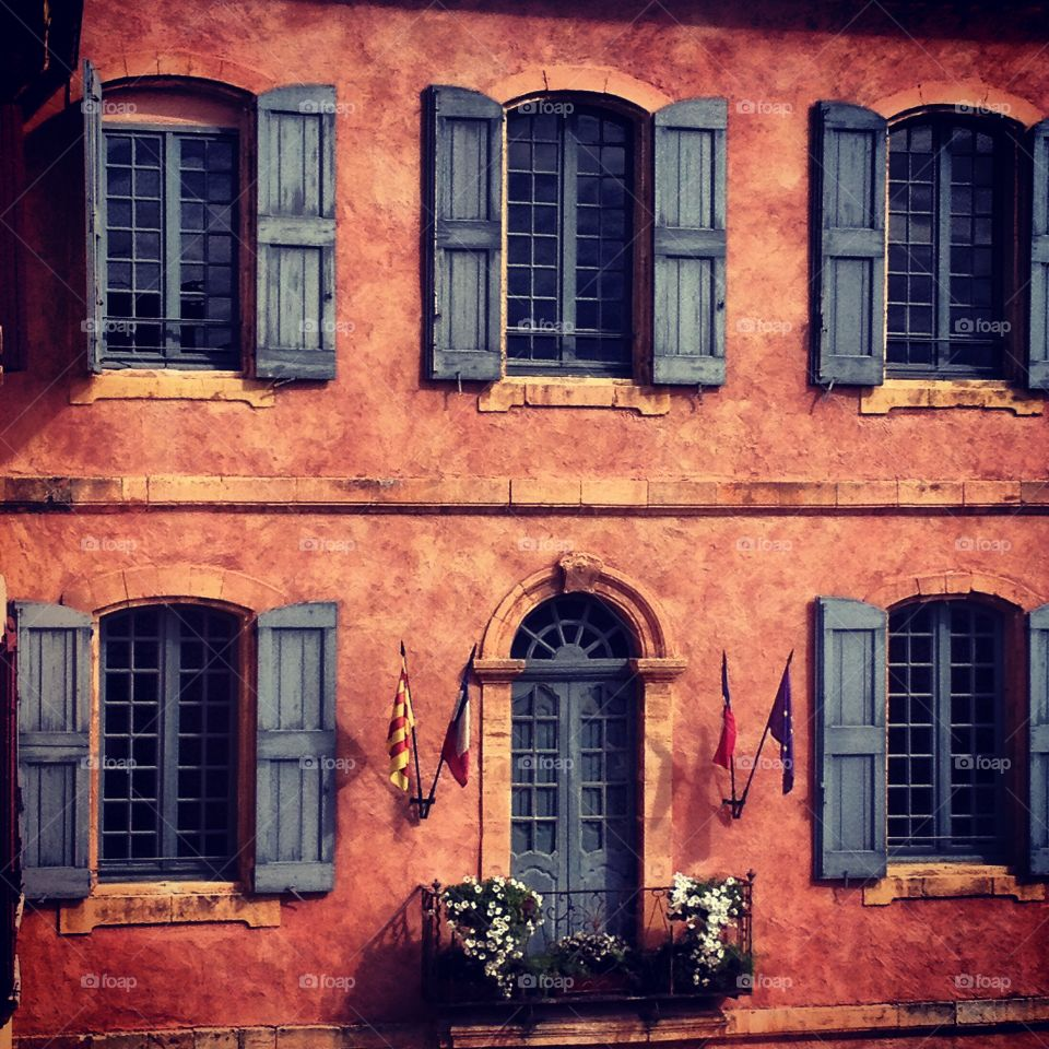 Terracotta building in Roussillon . Rousillion, Provence, France