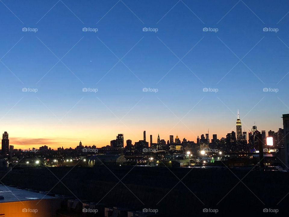 Sunset over the city that never sleeps New York. Beautiful sunset with the light just behind the busy city