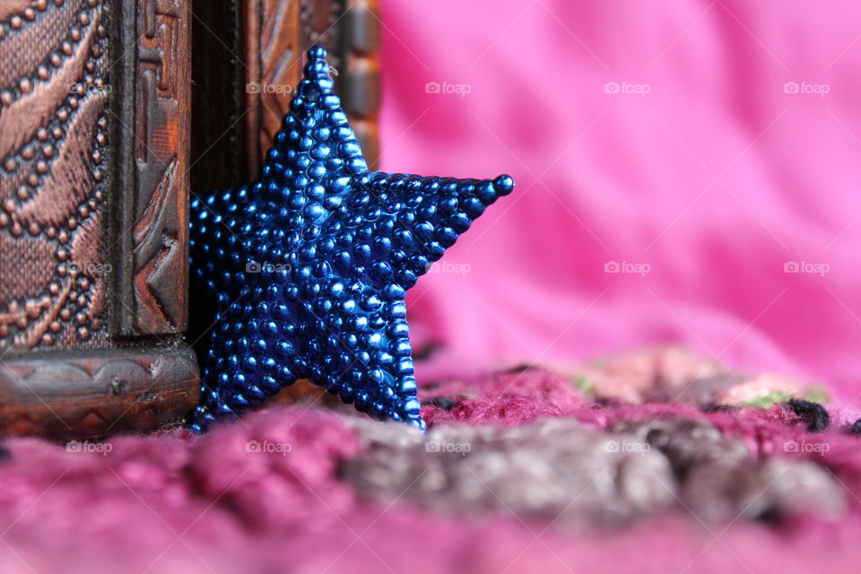 Close-up of blue star shape and wooden box