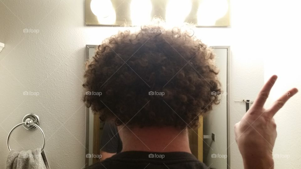 afro in bathroom mirror