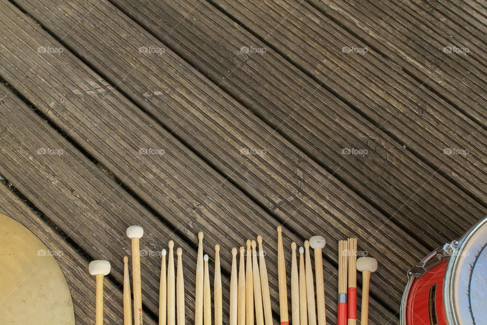 Various drumsticks on a wooden background