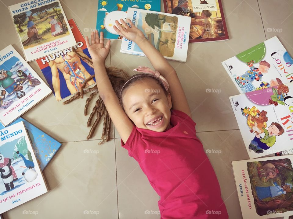 The happiness of the little girl for having read so many books that she loves