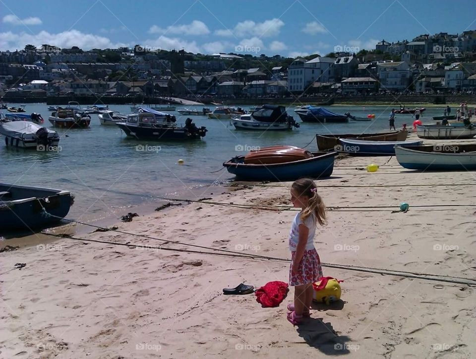blonde, Caucasian little girl ,looking out, at the, boats in St. Ives , cornwall, South,  West,  of, England,  United Kingdom,  of, great Britain,   summer time, sunshine,