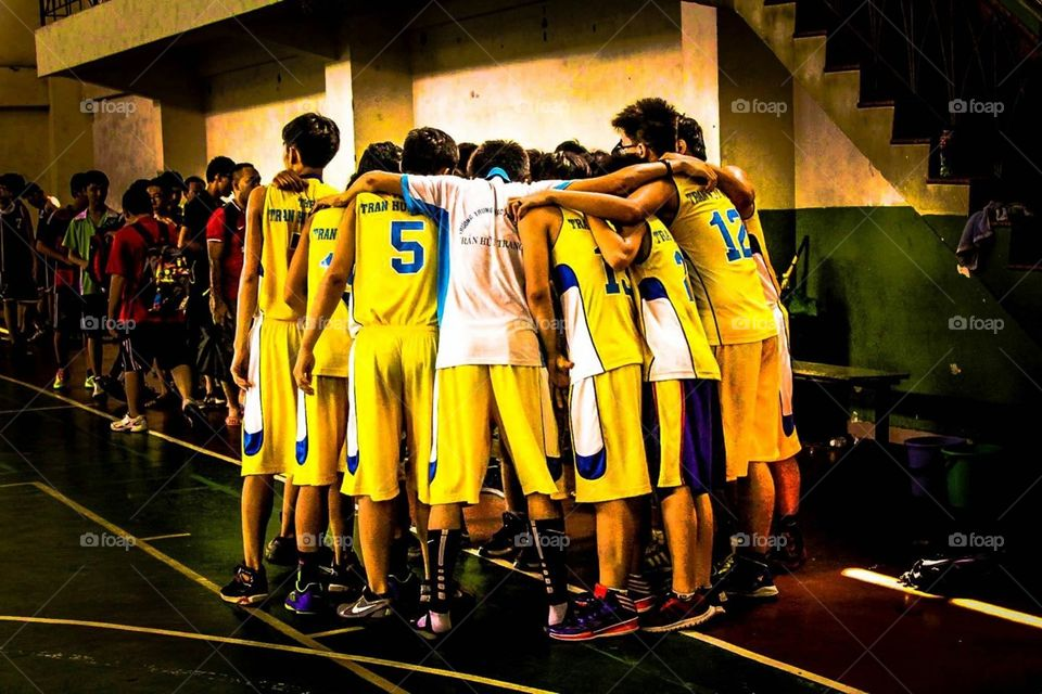Teammates . A small basketball team in Vietnam. A small team, but we're all have the same passion. Basketball and playing together