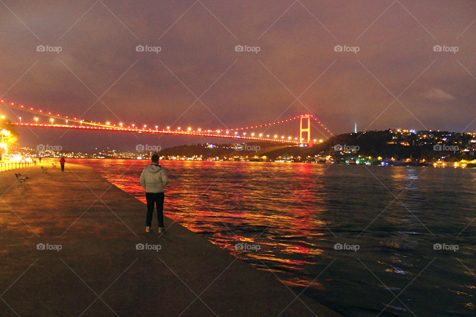 A beautiful bridge in Istanbul Turkey. A picture of the lights from a bridge in Istanbul reflecting in the Bosphorus Strait in Istanbul Turkey