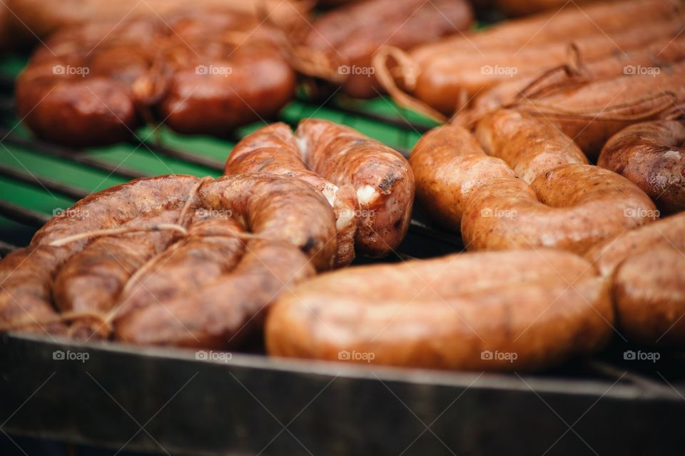 Close-up of sausages being prepared