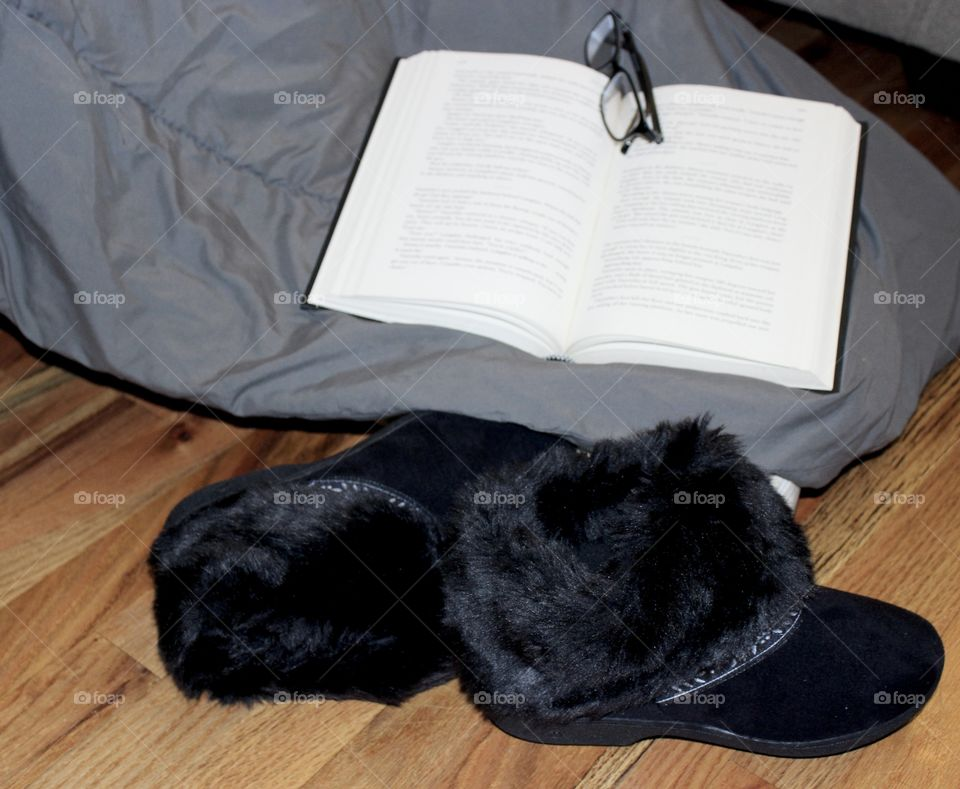 Black Faux Fur Slippers, book, and glasses on blanket