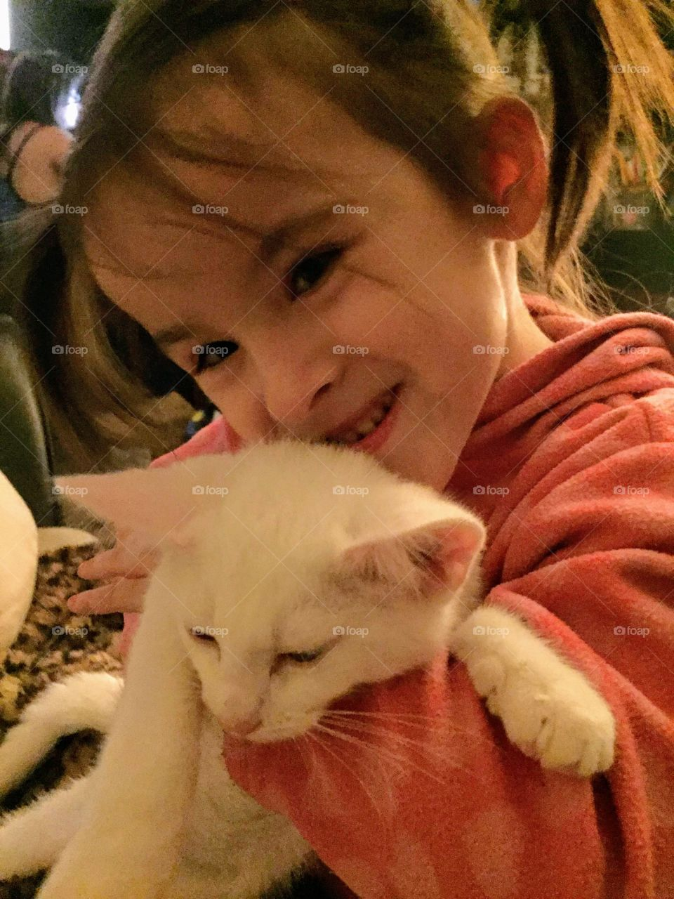 child and the love of her kitten