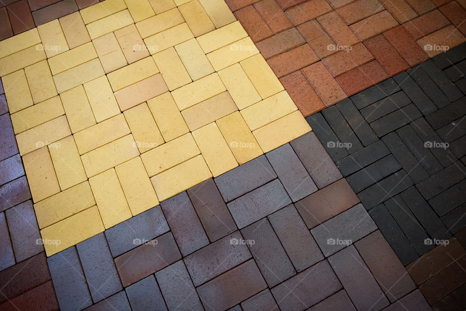 Stone pavement texture. Granite cobblestoned pavement background. Abstract background of modern cobblestone pavement close-up