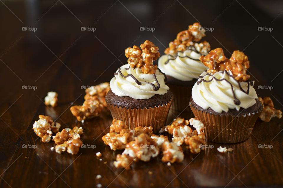 Chocolate cupcakes with popcorn garnish