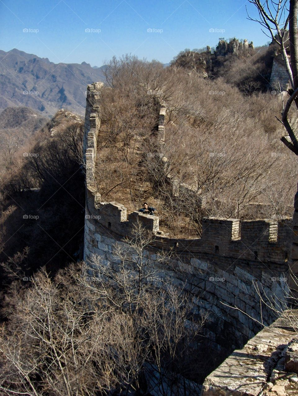 Ruins of the Great Wall near Beijing China, grown over with nature