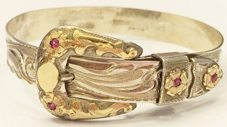 Handcrafted sterling silver and gold bracelet with rubies.