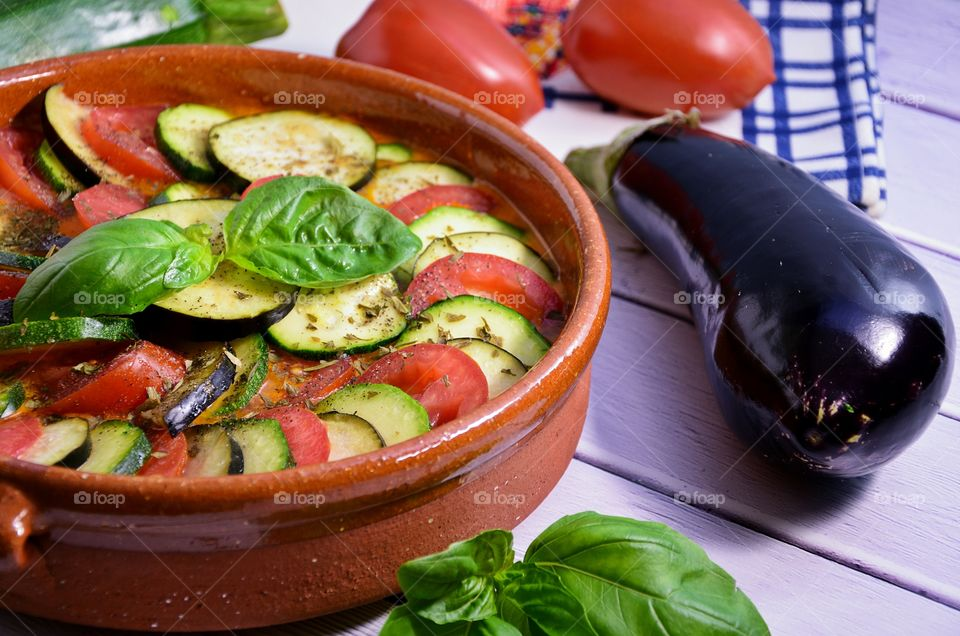 Sliced tomato and eggplant in cooking pot
