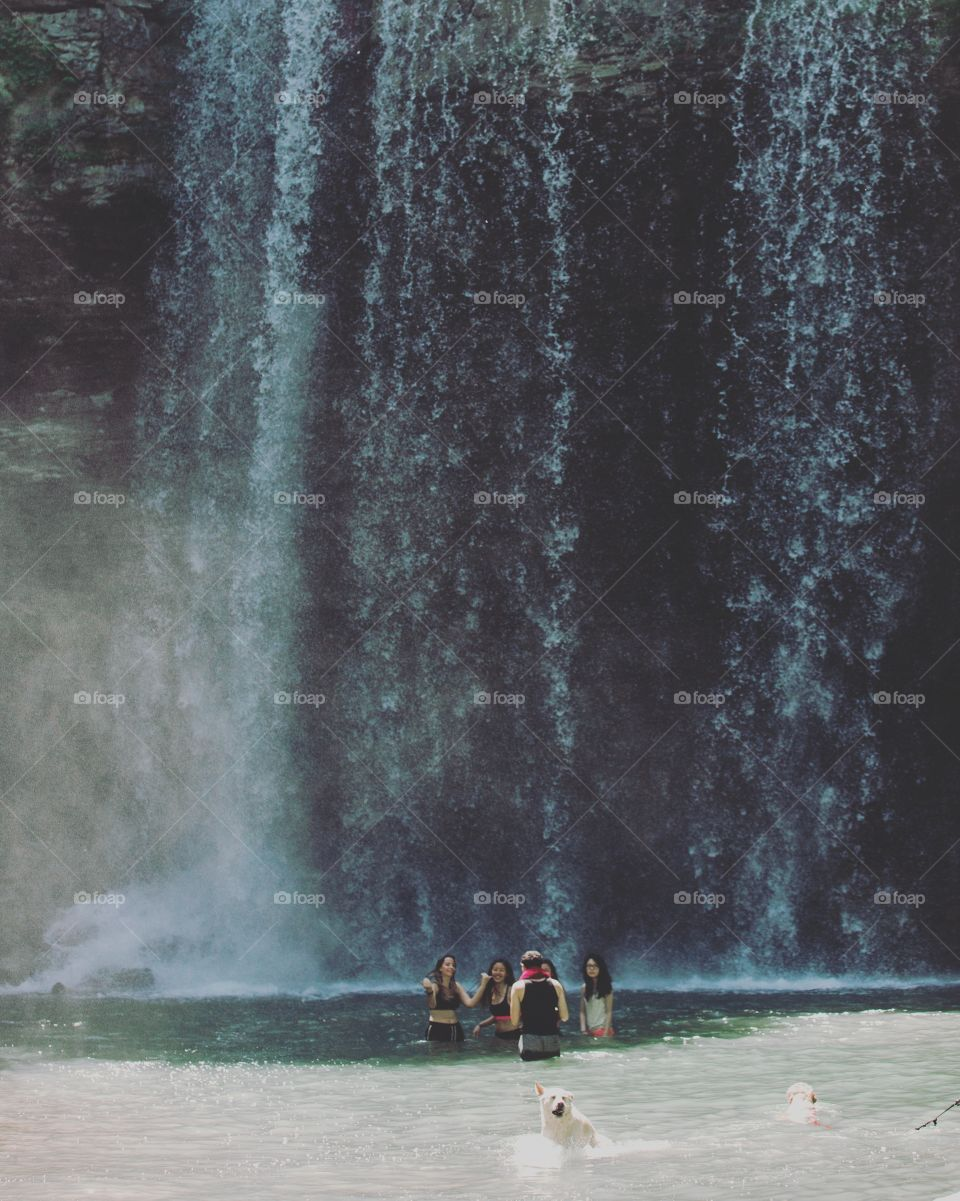 Playing under a waterfall