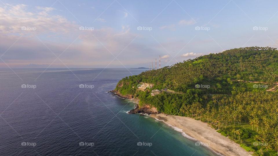 Aerial view lombok gili trawangan hidden beach small boat in ocean snorkling paradise indonesia lombok island